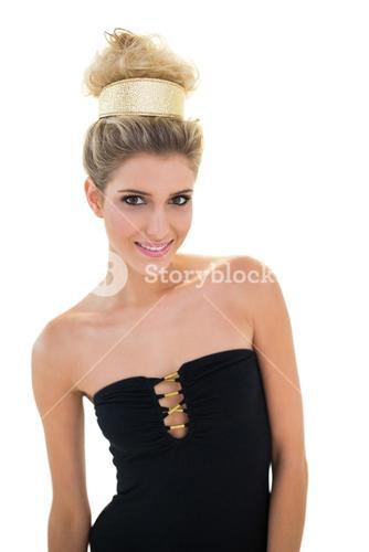 Content smiling blonde model with big hairstyle posing for camera
