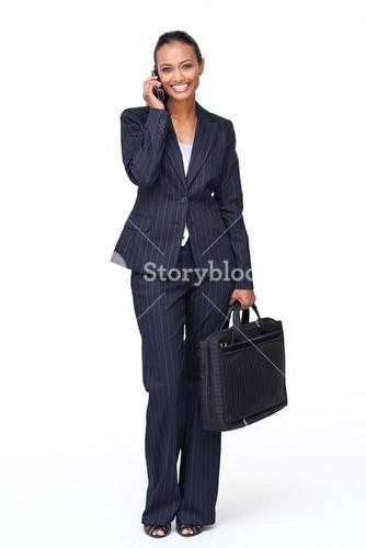 Smiling businesswoman on phone going to work