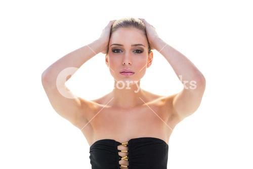 Stern attractive blonde model holding her head