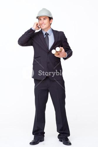 Standing handsome businessman against white