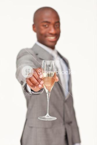 Businessman celebrating a success with champagne
