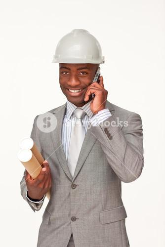 Attractive architect on phone holding plans
