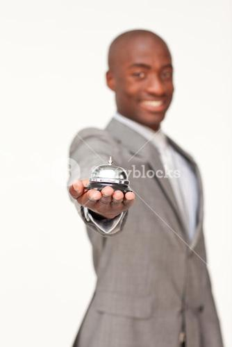 Businessman holding a hotel bell