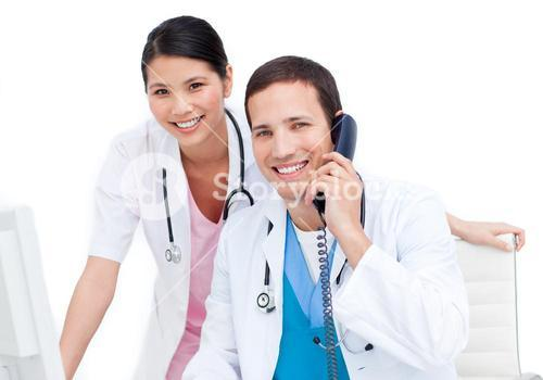 Happy medical team working at a computer