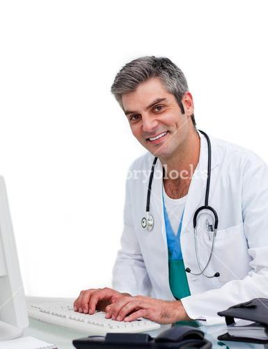 Smiling doctor working at computer
