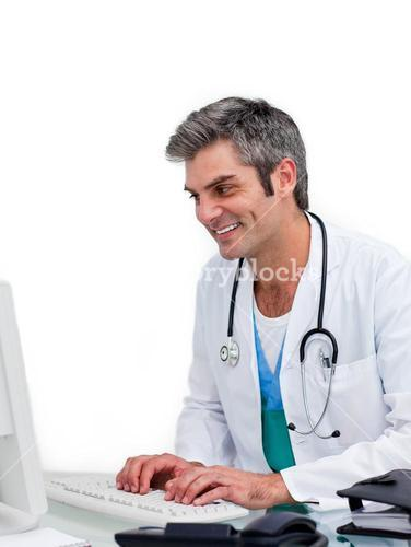 Happy doctor working at computer