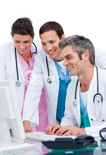 Enthusiastic medical team working at a computer