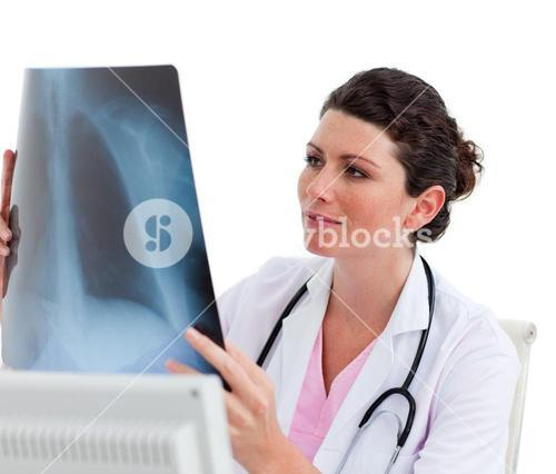 Happy doctor looking at Xray in his office