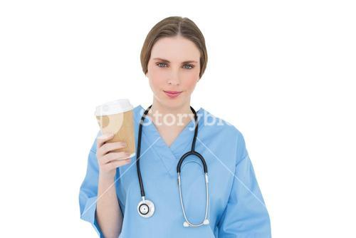 Young female doctor holding a coffee mug