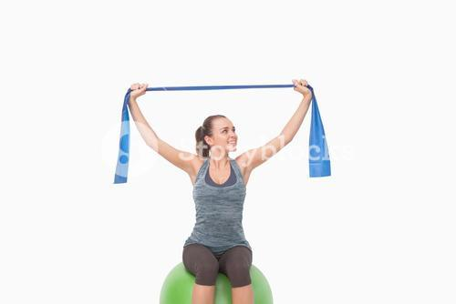 Cheerful woman training with a resistance band