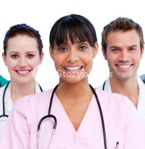 Smiling nurse with her colleagues