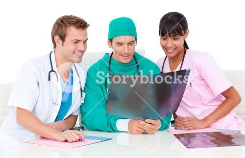 Confident medical team looking at Xray