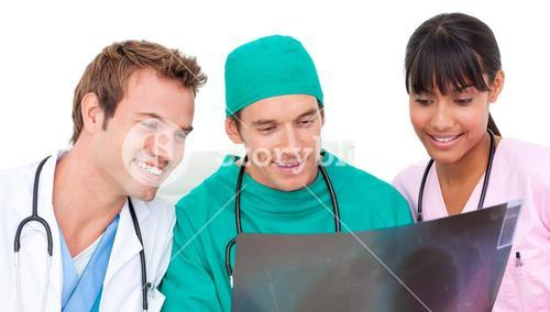 Enthusiastic medical team looking at Xray