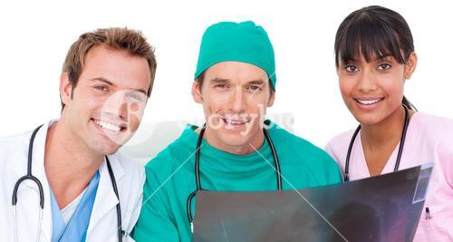 Portrait of medical team looking at Xray
