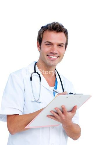 Handsome surgeon writting a report