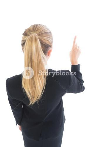 Ponytailed business woman pointing