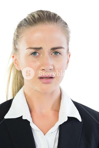 Portrait of upset young businesswoman
