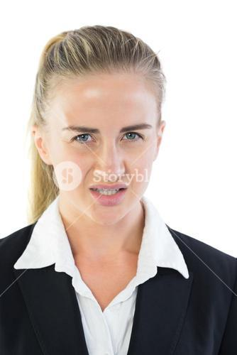 Portrait of irritated young businesswoman