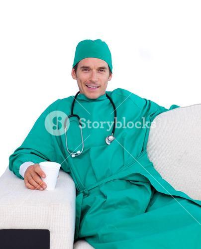 Charismatic surgeon drinking coffee in the staff room