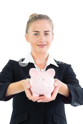 Gorgeous young businesswoman holding a piggy bank
