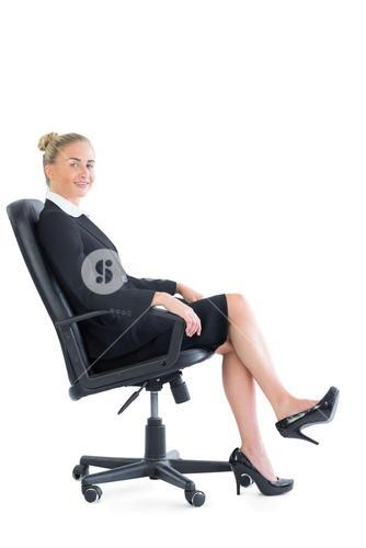 Gorgeous chic businesswoman sitting on an office chair