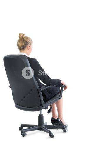Rear view of chic businesswoman sitting on an office chair