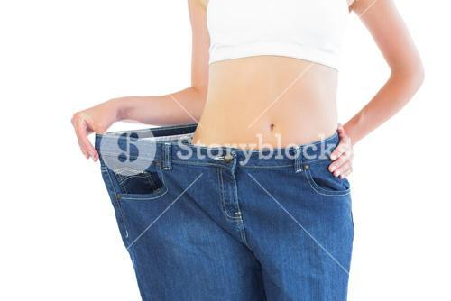 Close up of confident slender blonde wearing too big trousers
