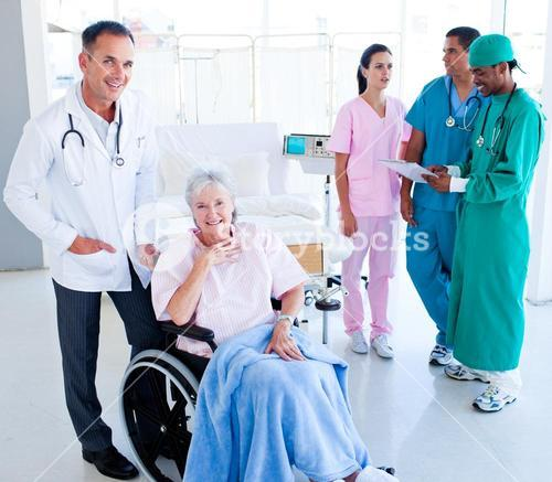 Positive medical team taking care of a senior woman
