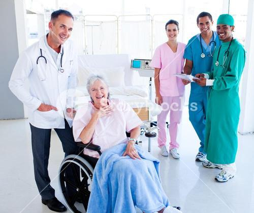 United medical team taking care of a senior woman