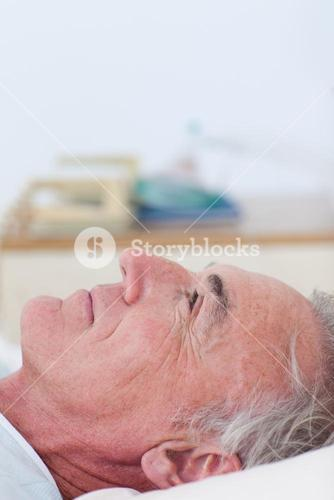 Senior patient lying on a hospital bed