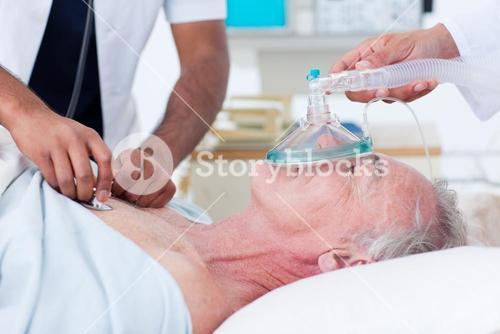 Doctors resuscitating a senior patient