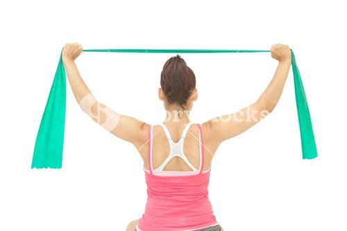Sporty brunette stretching with resistance band