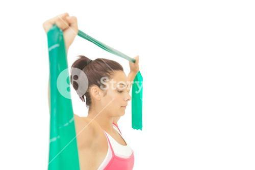 Content sporty brunette stretching with resistance band