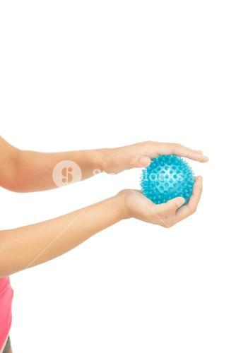 Close up of female hands holding blue massage ball
