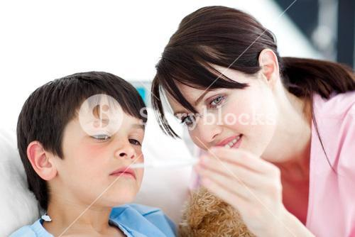 Attentive nurse and his patient looking at a thermometer