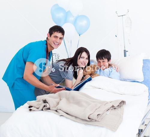Smiling little boy, his mother and a doctor having a talk