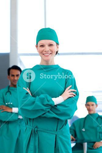 A group of doctors wearing surgical gown