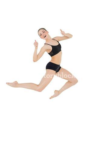 Cheerful slim model jumping in the air