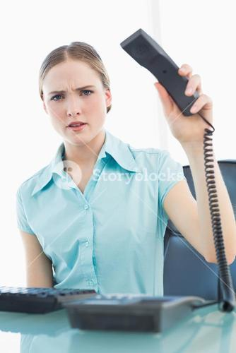 Classy furious businesswoman hanging up phone