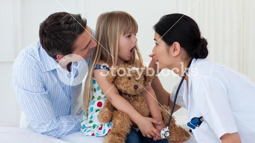 Doctor examining childs throat