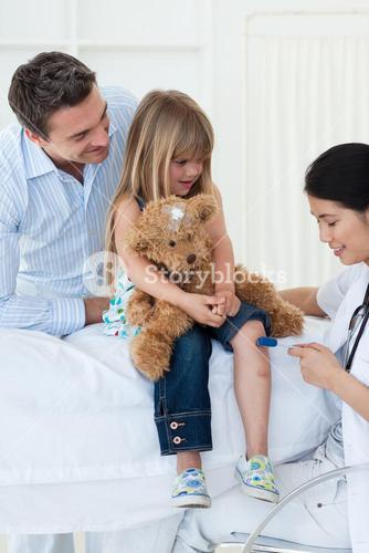 A doctor checking childs