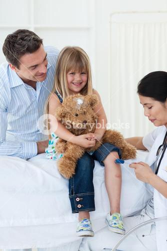 Female doctor checking patients reflex