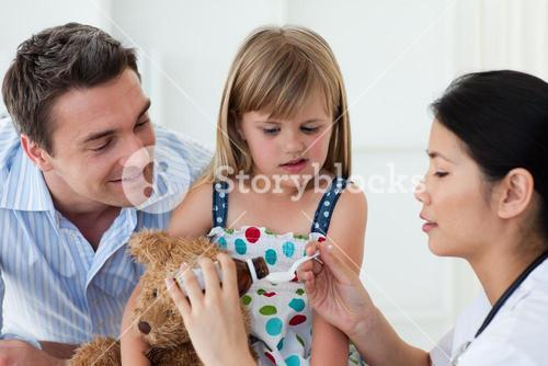 Serious female doctor giving medecne to a little girl