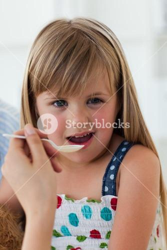 Close up of little girl taking medecine