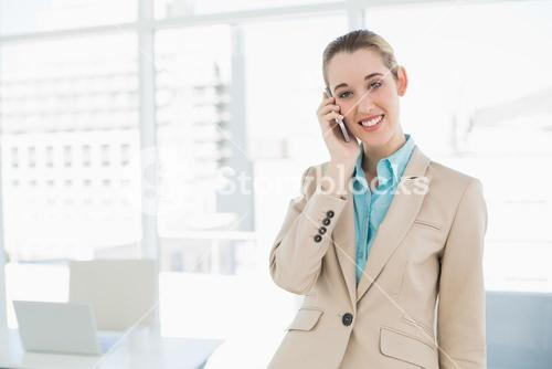Portrait of chic businesswoman phoning with her smartphone