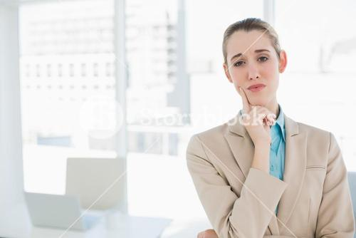 Chic thoughtful businesswoman posing in her office