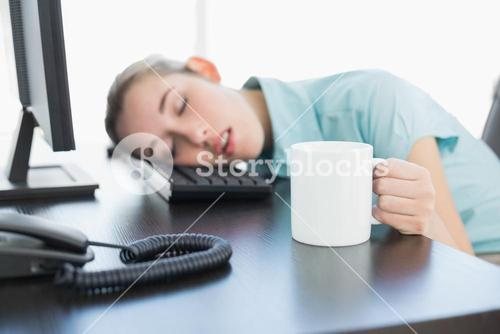 Cute businesswoman sitting on her swivel chair napping
