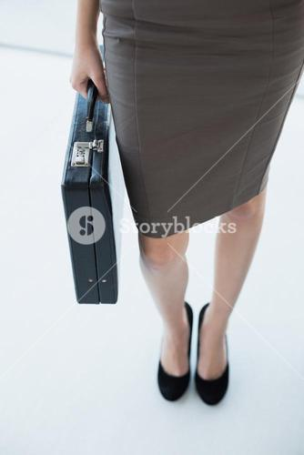 Classy businesswoman holding a black briefcase