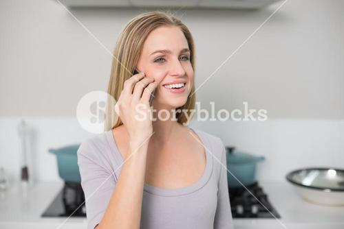 Cheerful gorgeous model phoning
