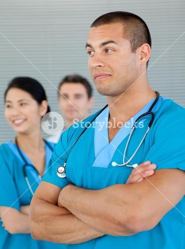 Doctor with his colleagues in the background